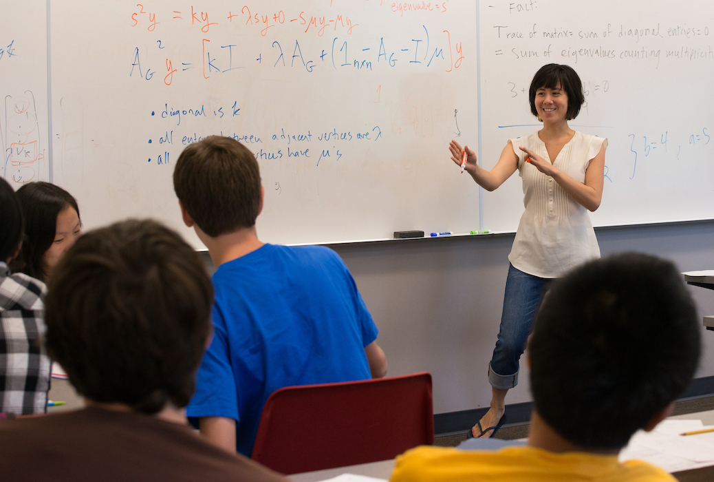 Photo of a Mathcamp mentor teaching a class on spectral graph theory.